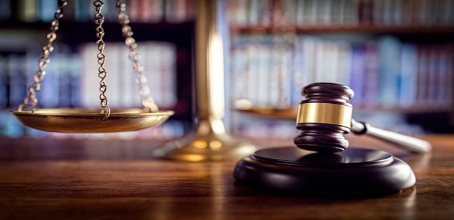 What does a professional indemnity policy for lawyers include?