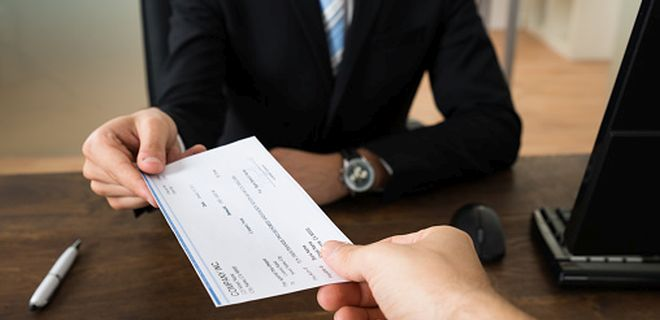 Can a cheque drawn in favour of guardian be deposited in minor's account?