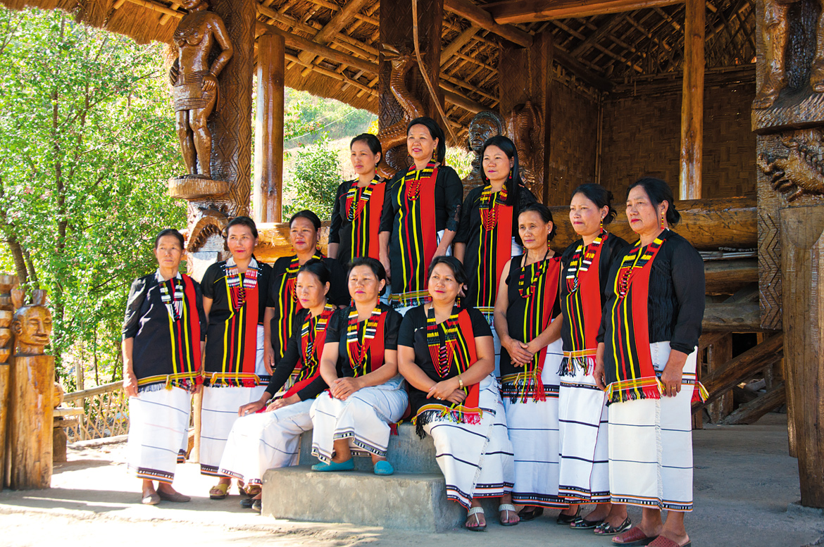 Performers pose for a photo-op at their morung