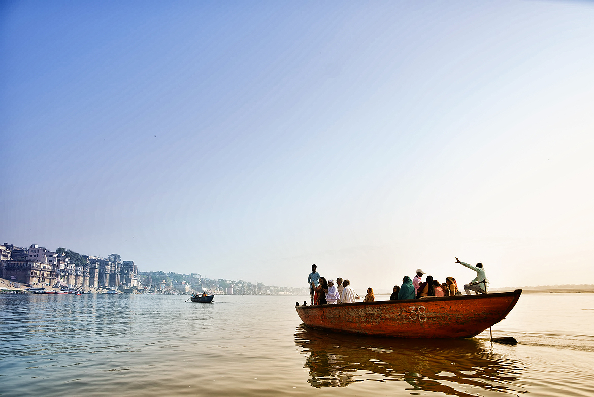 On an early morning boat ride on the Ganga, a tour guide spins tall tales about the city