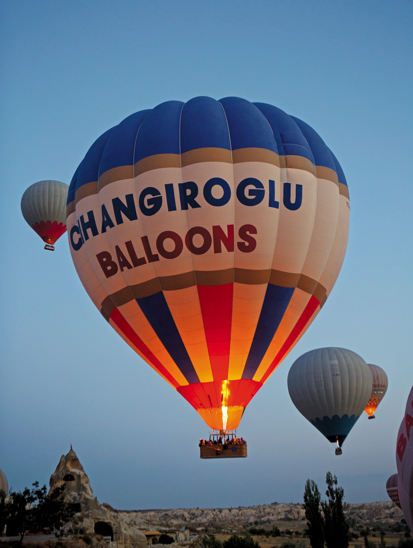 Finally warmed up, hot air balloons take flight