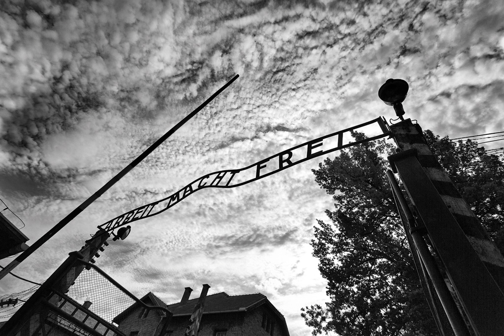 The entrance arch at the Auschwitz concentration camp, Poland. Like some other Nazi concentration camps, it bears the infamous words, ԁrbeit Macht FreiԠ(work sets you free).