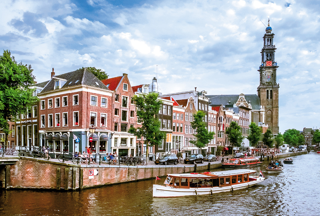 The canals of Amsterdam, Netherlands. The Grachtengordel, or the concentric circles formed by the original moat and three main canals of Amsterdam, are the keystone of its exemplary city planning.