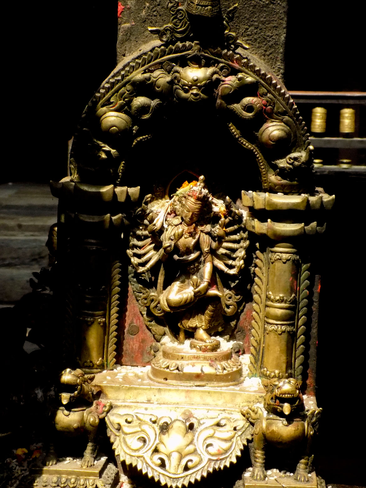 At the Kwa Baha, you will find depictions of 12 forms of the Bodhisattva Avalokiteshwara, including this one, Nrityeshwar. Avalokiteshwara is the most important deity of Patan, and maybe even the entire Kathmandu Valley. The cult of Karunamaya or Rakta Lokeshwara is the basis of the biggest religious festival of Patan, the Karunamaya Rath Yatra. Hindus identify Karunamaya with the Saiva siddha Macchendranath