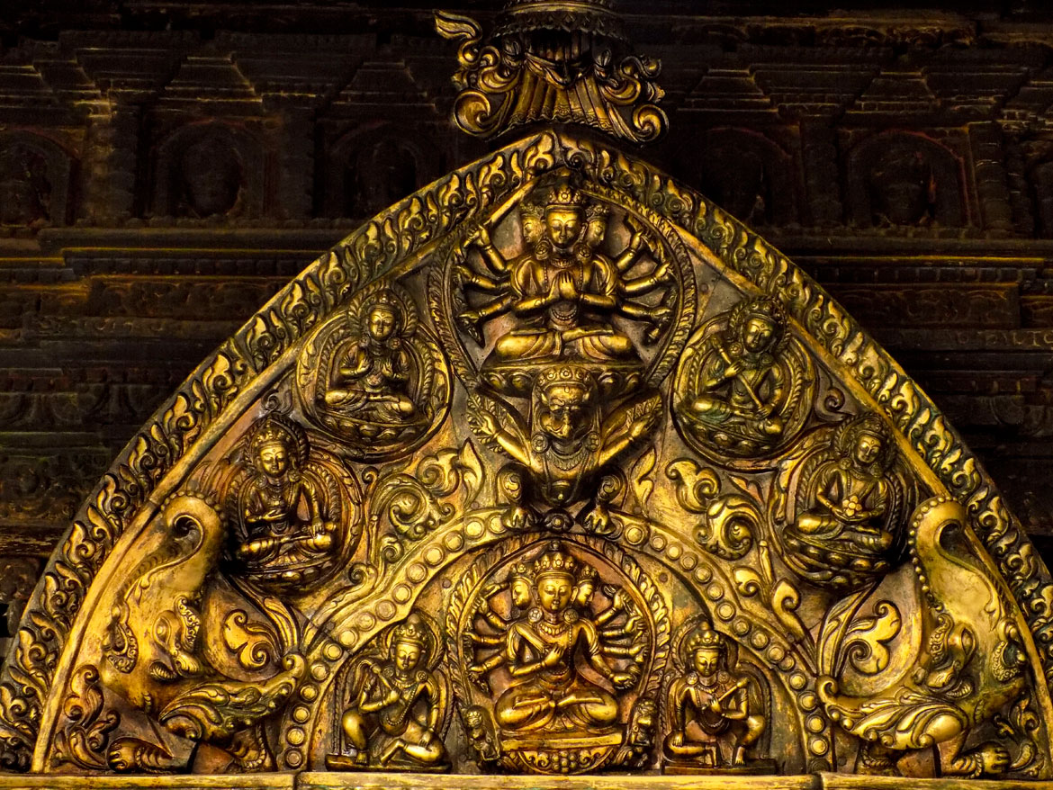 The Newars are masters of repoussé¡·ork, especially when working with gold. This gorgeous artwork at the top of one of the toranas or doors of the Swayambhu chaitya is proof of their mastery