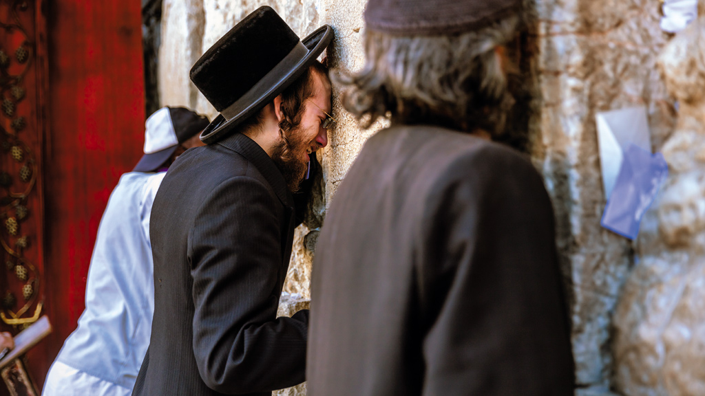 A Jew grieves the loss of his temple, Western Wall, Jerusalem, Israel. Western Wall is what remains of the holiest site of the Jews.