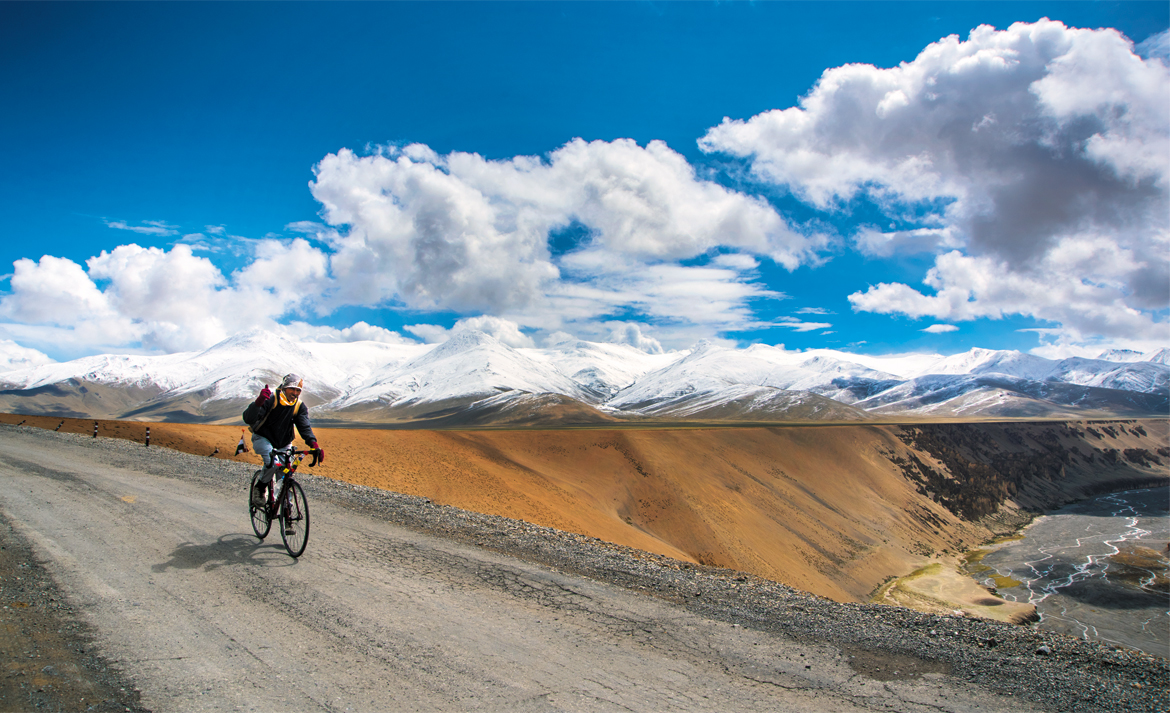 A mountain biker cruises along at More plains