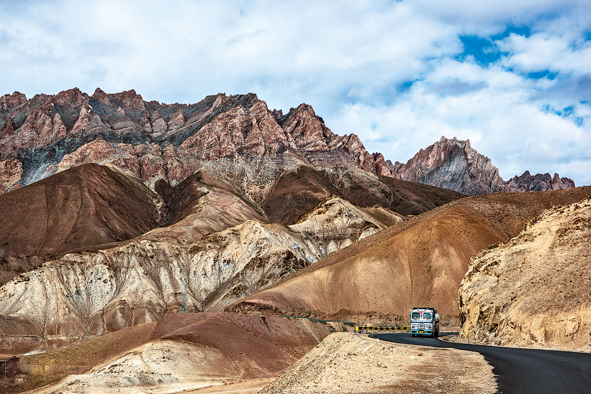 A truck seems to be the only living entity amid the barren hills near Fotu La