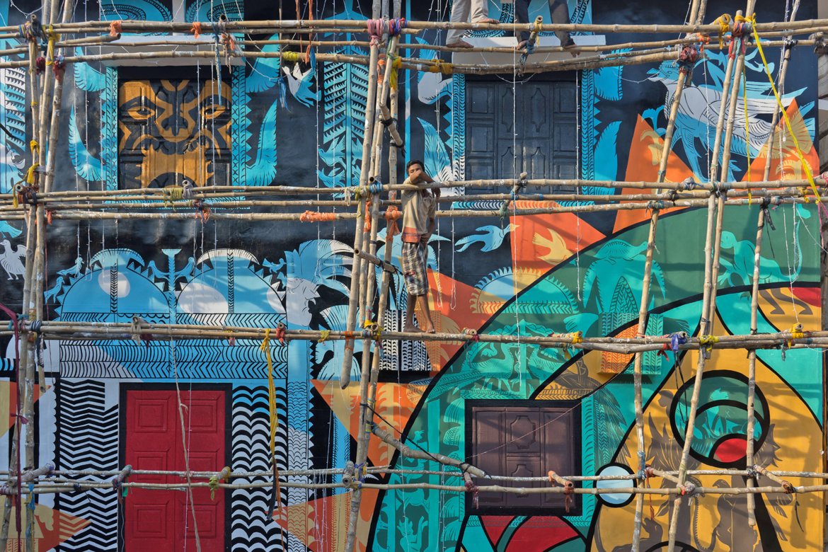 Pretty murals make for pretty pictures in the backdrop of Durga Puja preparations