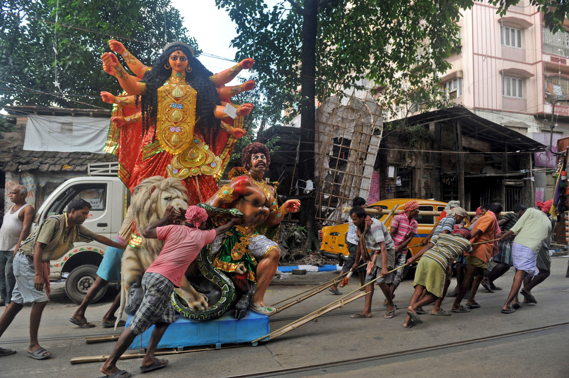 Maa is transported from Kumartuli to her home for the Pujos