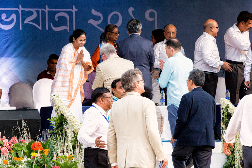 CM Mamata Banerjee greets dignitaries before the start of the immersion carnival