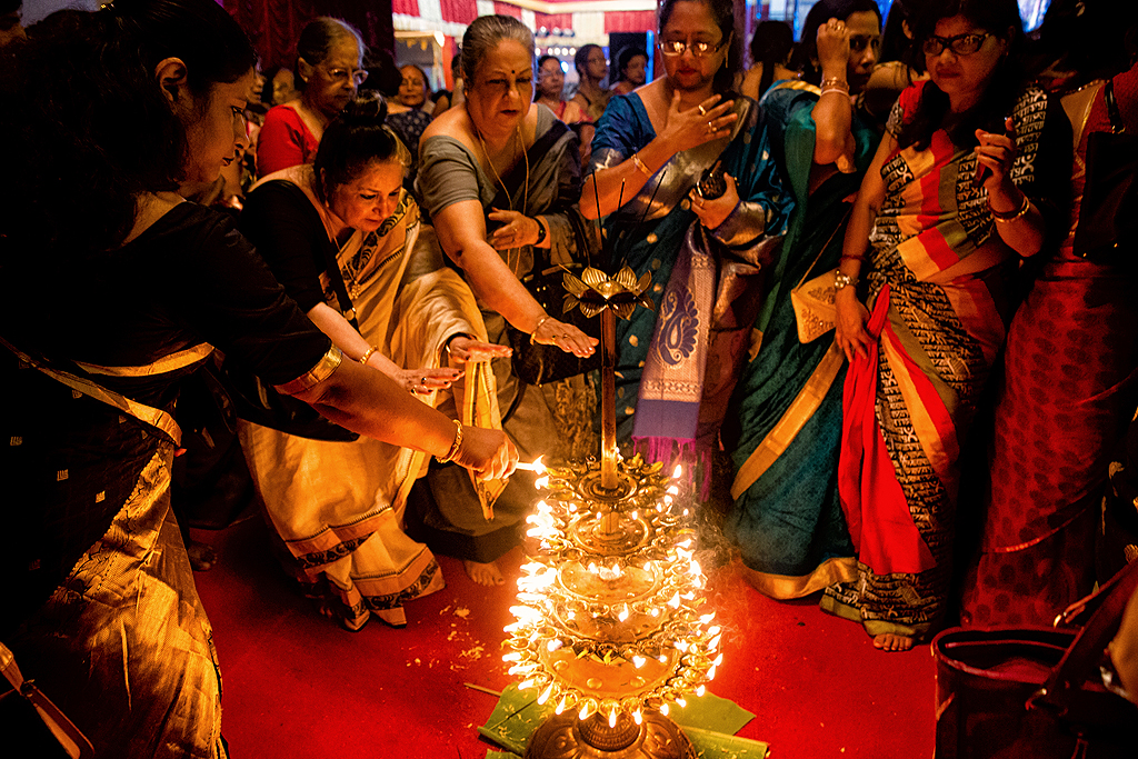 108 lotus flowers are required and lamps are lit for this special Sandhi pujo