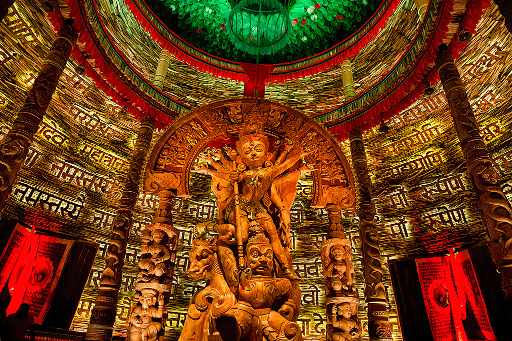The pandal at Chetla Agrani resembles a Shiv Lingam from the outside and inside, different types of wood have been used to create the fantastic theme