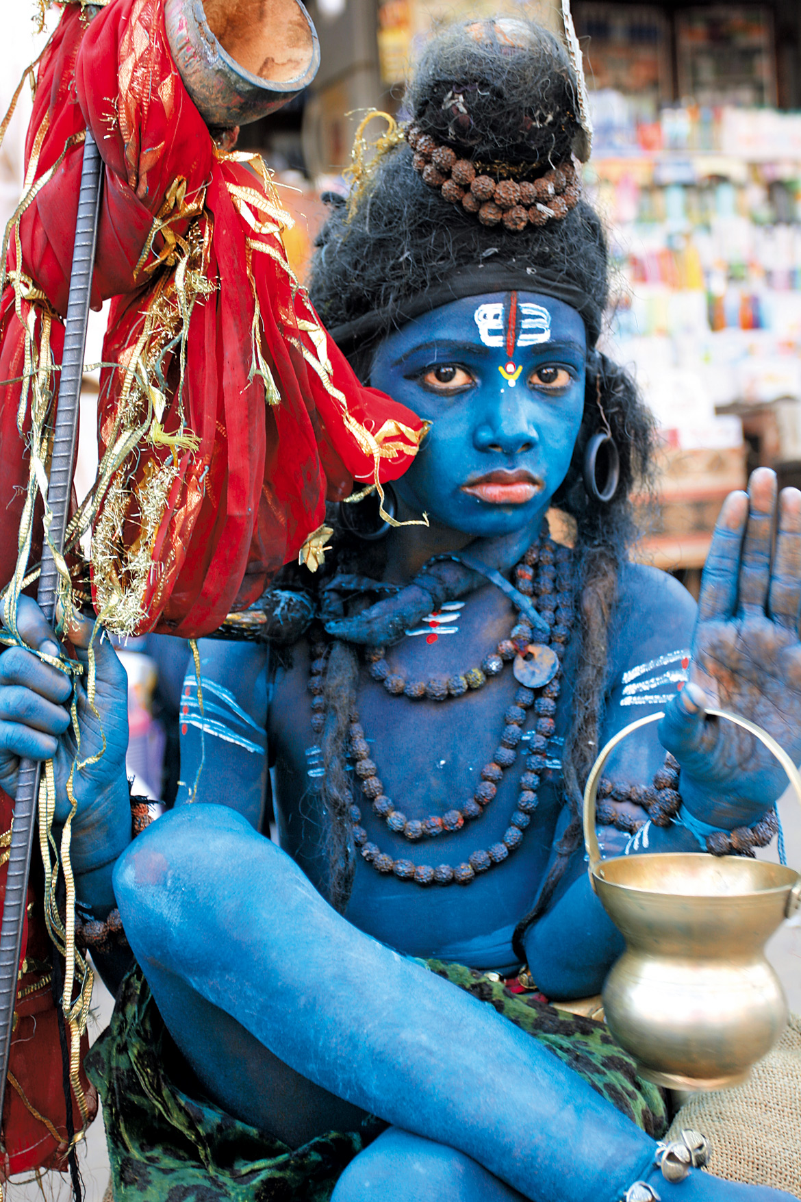 A boy dressed up as Lord Shiva