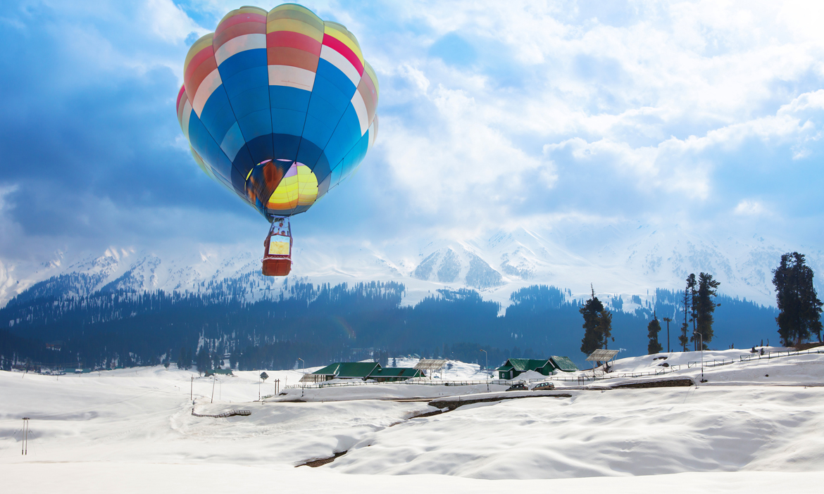 Gulmarg, Kashmir: Balloon over a village in the middle of Himalaya mountains at dusk