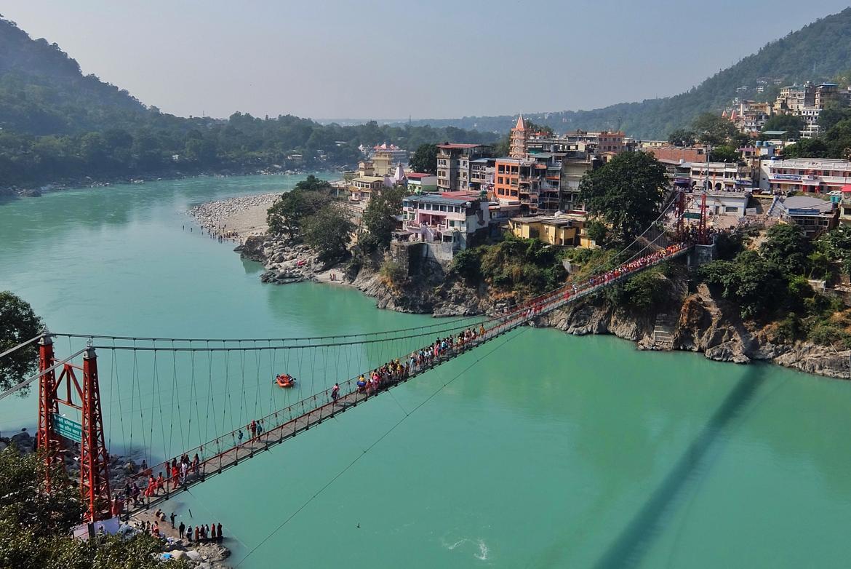 View of Ganga river and Lakshman Jhula bridge in Rishikesh