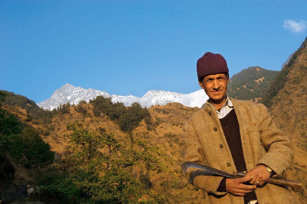 Photo Credit: Puneet K. Paliwal, A Gaddi shepherd with the Dhauladhar range behind him