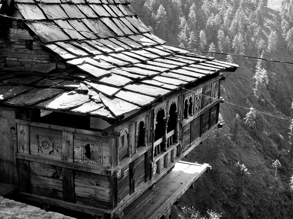 An alpine hut with slate roof tiles and pine panelling