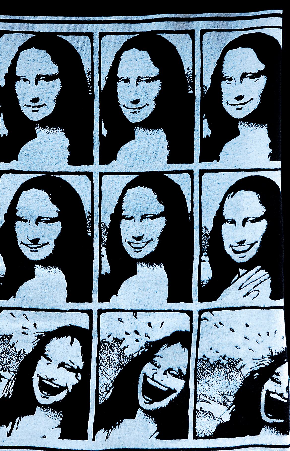 A passerby wears a T-shirt with variants of the Mona Lisa smile