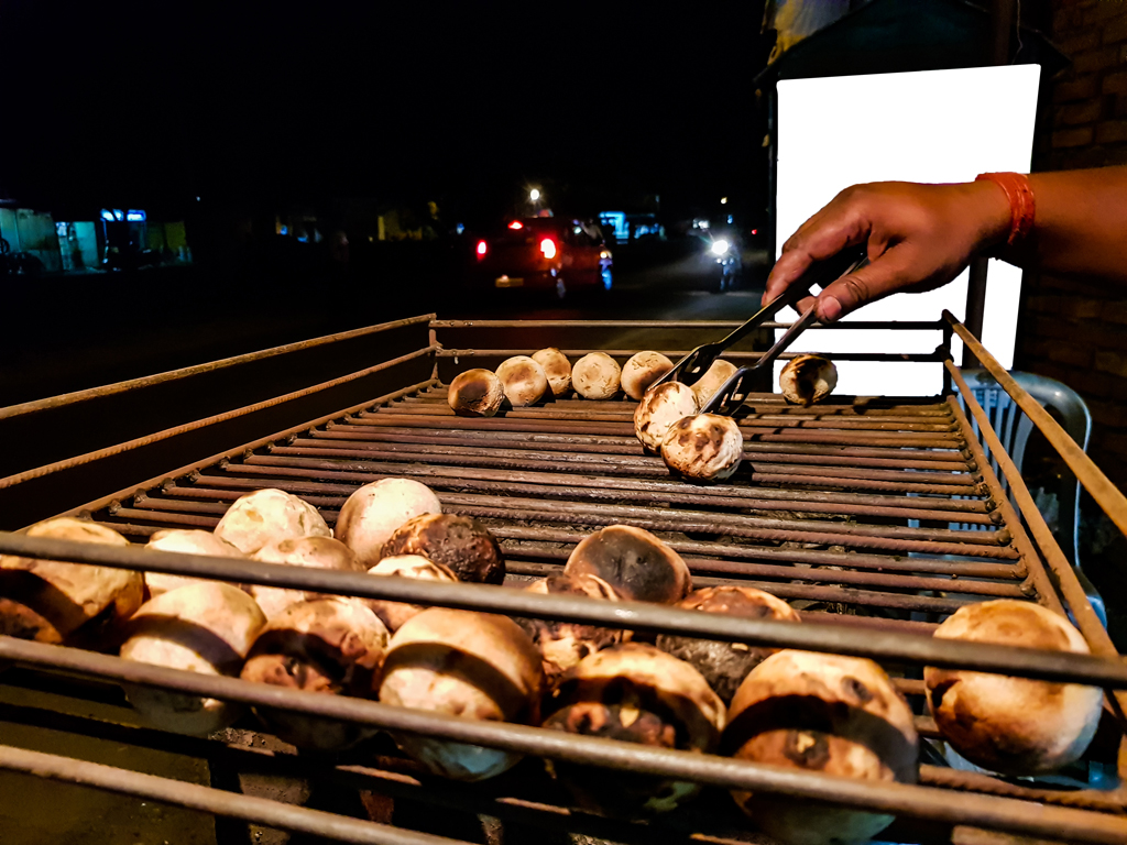 Litti, a Bihari food is being baked roadside on a coal grill