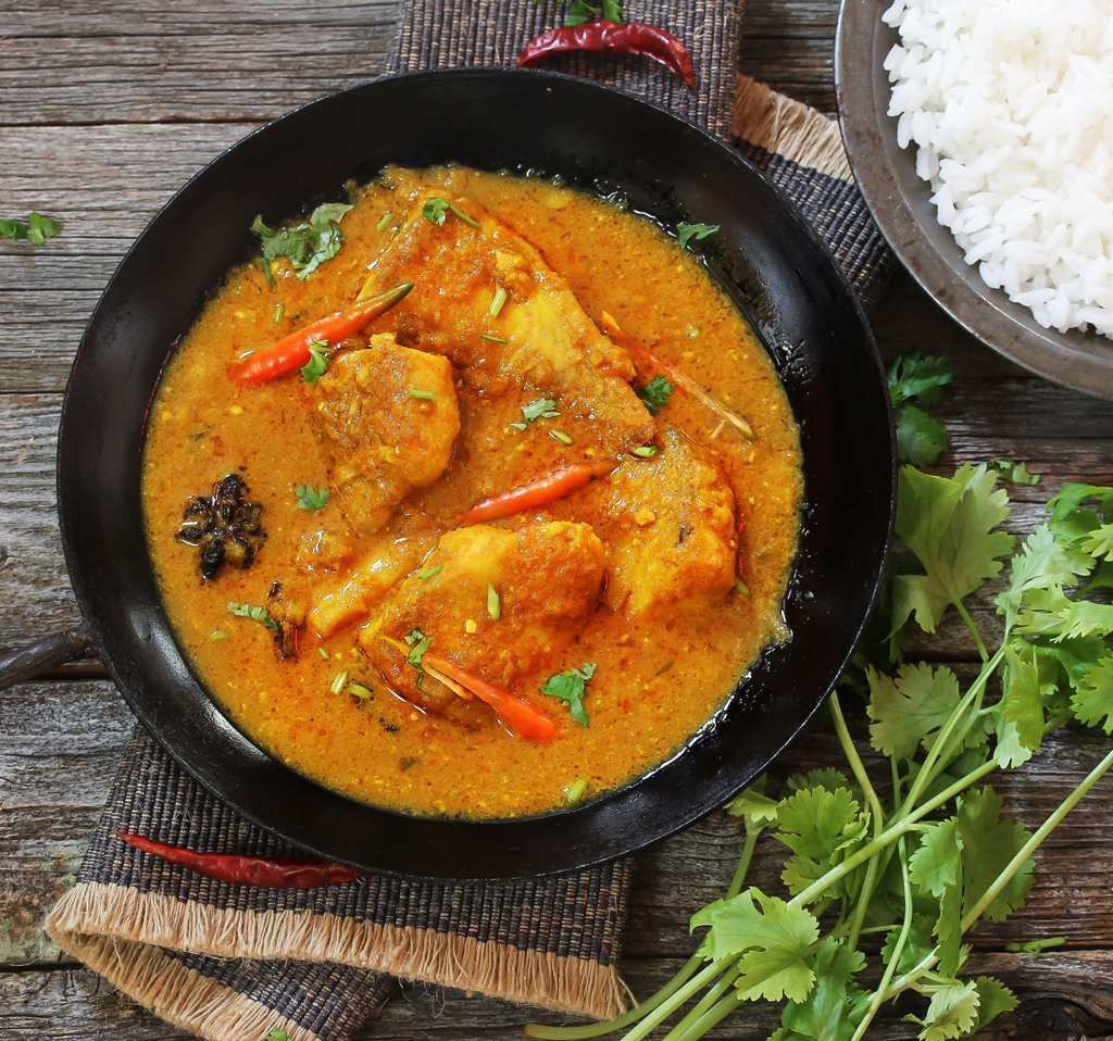 Bengali fish curry served with rice