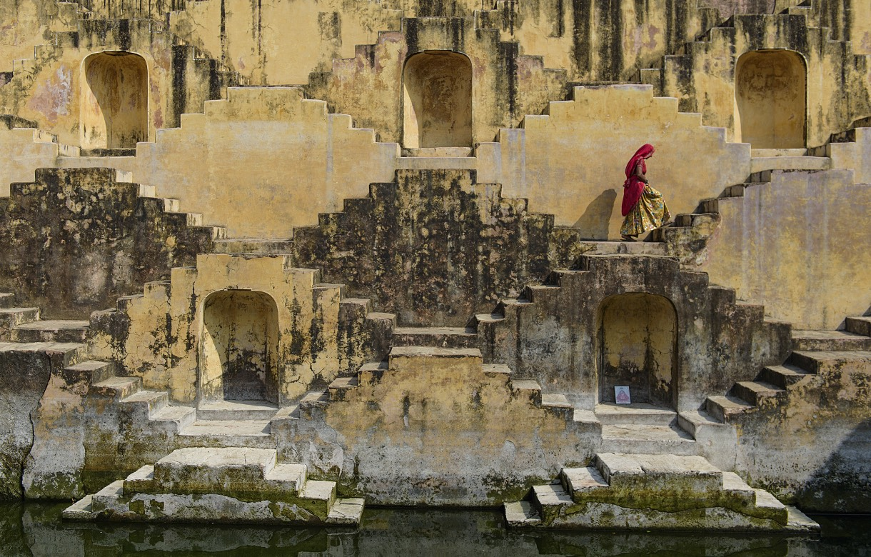 A local woman exiting a stepwell