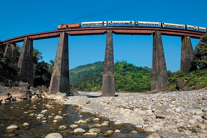 A train clears the Bathu Khad Bridge on the Kangra Valley Railway