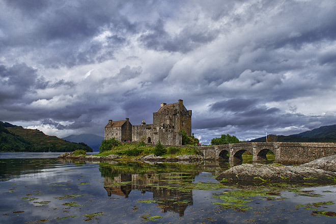 Eilean Donan castle - The castle sits on top of a small tidal island right where three lochs meet, in the western highlands