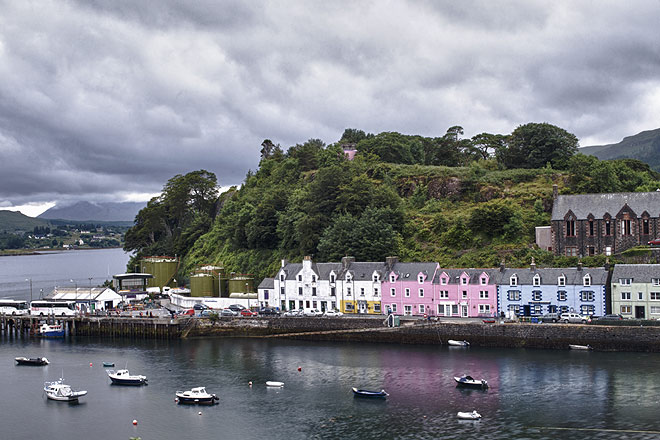 The colourful houses in Portree stand out against the cloudy sky, a cheery sight welcoming visitors to the Isle of Skye