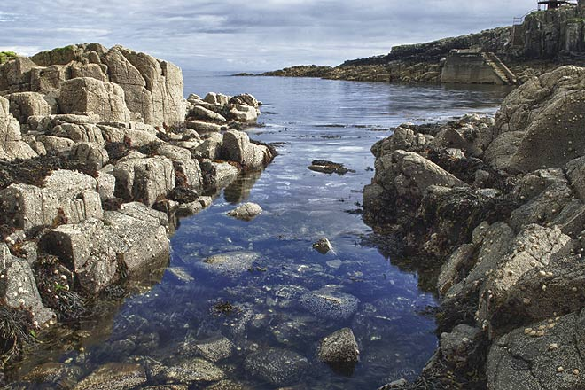 Explore along the rocks and small pools that surround Neist Point