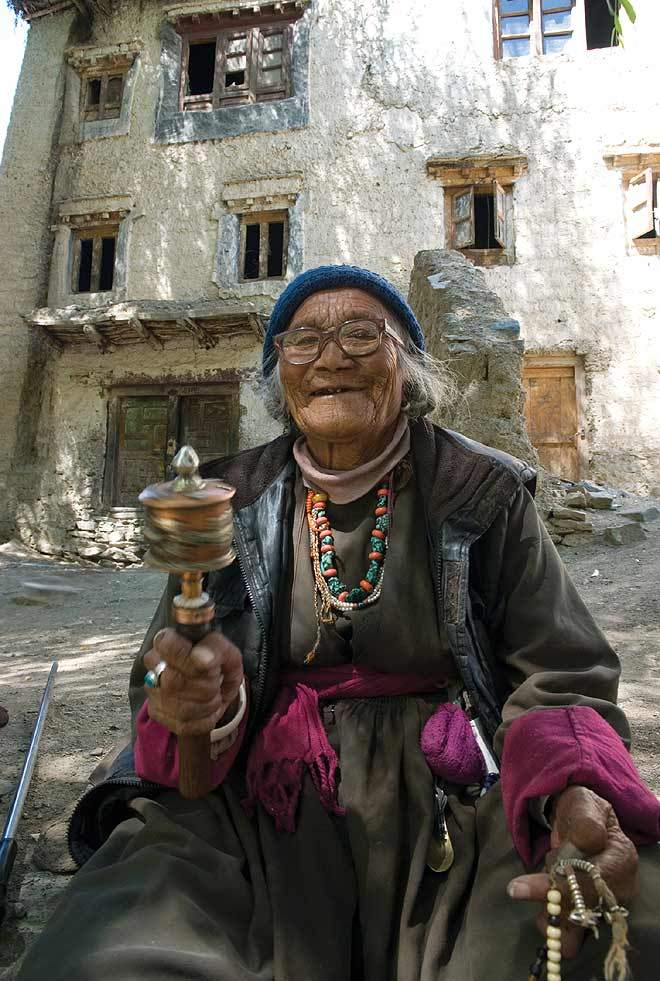 An old woman with her prayer wheel