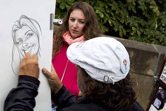 This caricature-potrait artist is one of the many artists, artisans and musicians who are on Charles Bridge all day