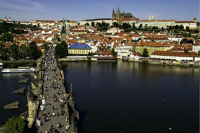 Charles Bridge during the day, over the river Vltava, which cuts through Prague
