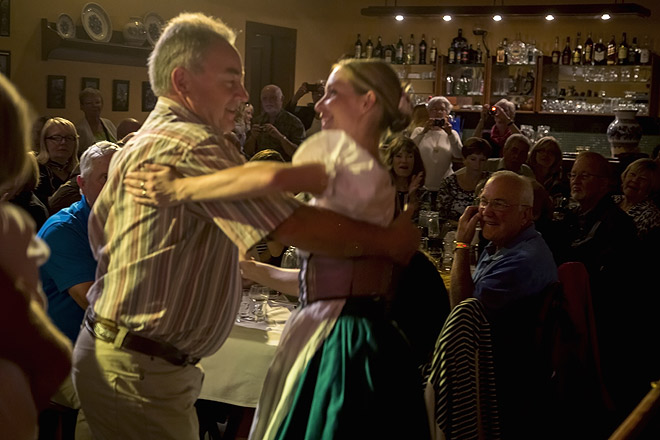 A tourist gets an impromptu lesson from a Czech dancer