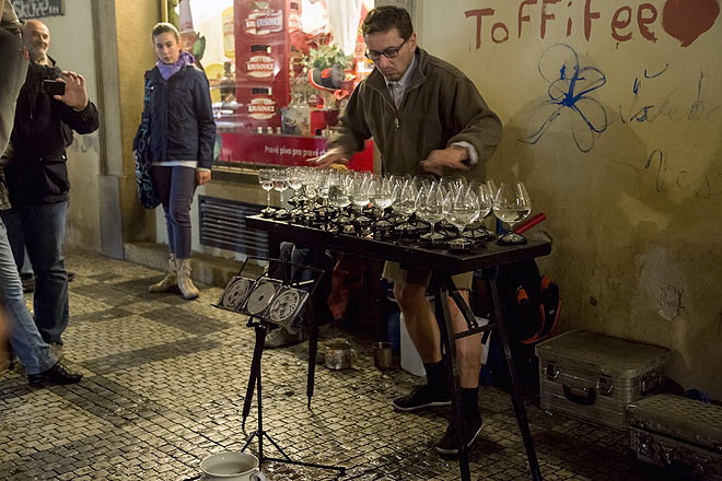 A street musician in Prague creates melody from wine glasses
