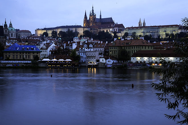 Prague Castle across the Vltava in the 'blue hour'. The castle complex, one of the largest in the world, is in the Hradčany district. It has the official residence of the Czech premier.