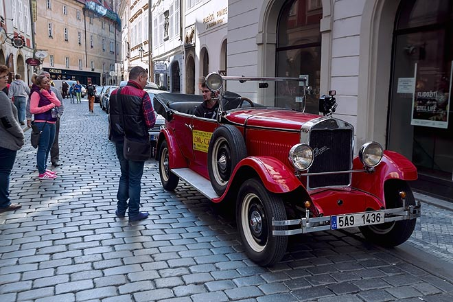 A vintage taxi ride is another way of sightseeing in Prague