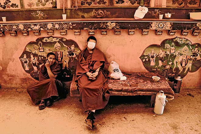 Monks at the Samye Monastery nap between chores