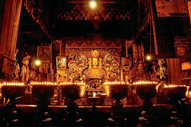 Butter lamps illuminate the Sakyamuni Buddha in Tsedang's Samye Monastery