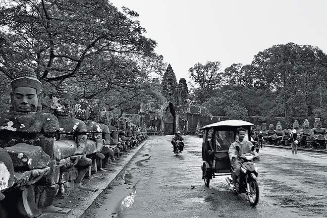 Approaching Angkor Thom: The walled city of Angkor Thom is usually entered through the southern gate, a classic photo op