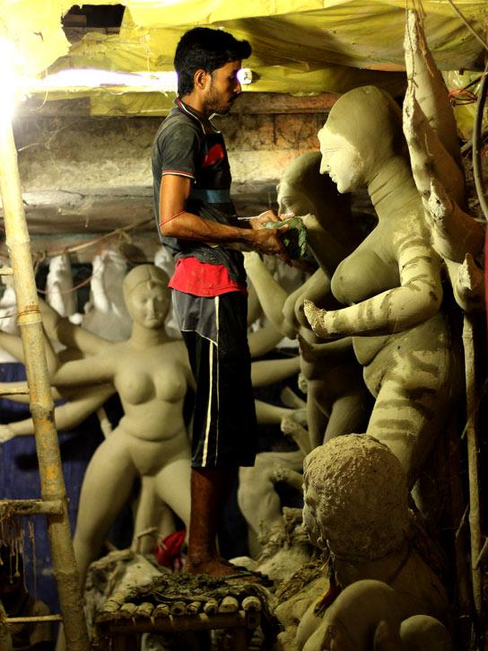 Durga Puja - the common 'favourite five days' in every Bengali's life - is knocking at the door. But the fun can only begin once Durga, with her four children, reaches her 'baaper bari' (paternal home). And so it's the artisans at Kumartuli who are literally on war footing now to get this entourage ready on time.