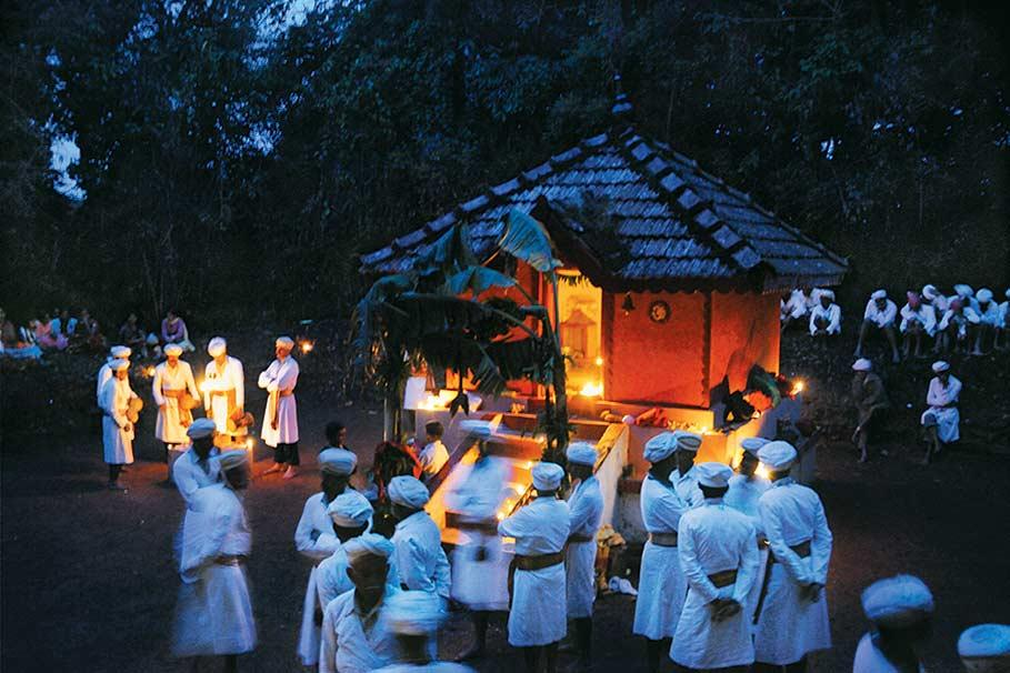 Dawn breaks over the forest shrine of Mythilappa, where men have sung and danced through the night in honour of the deity. From the book The Vanishing Kodavas (Eminence Designs, Rs 7,500). Text by Kaveri Ponnapa, photographs by Sudeep Gurtu.