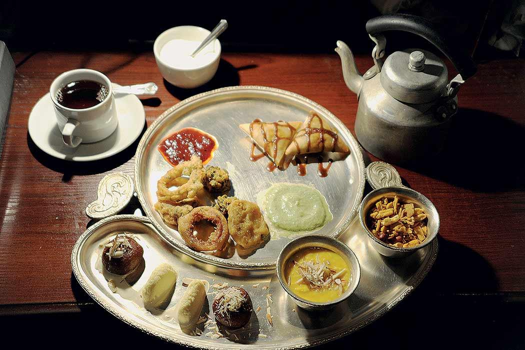 This artistically styled ethnic tray at Chor Bizarre restaurant in London, showcases some Indian savouries and cuisine that typically go with the vigorous strength of Indian Chai. Chor Bizarre serves a high-tea menu every afternoon when it becomes