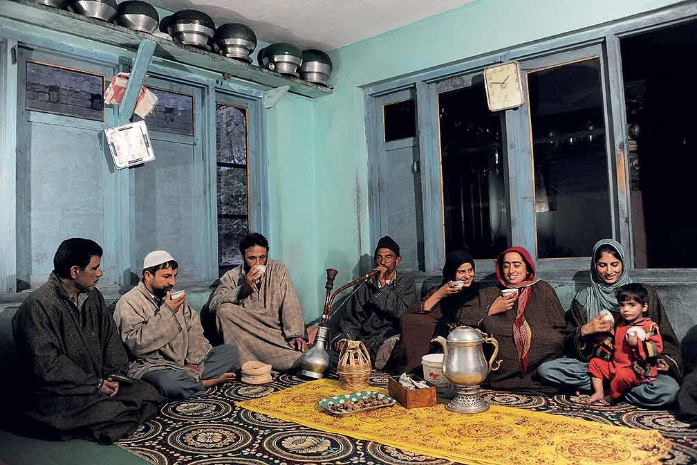 Delights in a Kashmiri home. Nothing is more relaxing than a hookah and a sip of kahwa tea with the family. In the centre stands an engraved samovar to keep the brew warm.  (From the book Chai: The Experience of Indian Tea, by Rekha Sarin and Rajan Kapoor; Published by Niyogi Books; Price Rs 1,995)