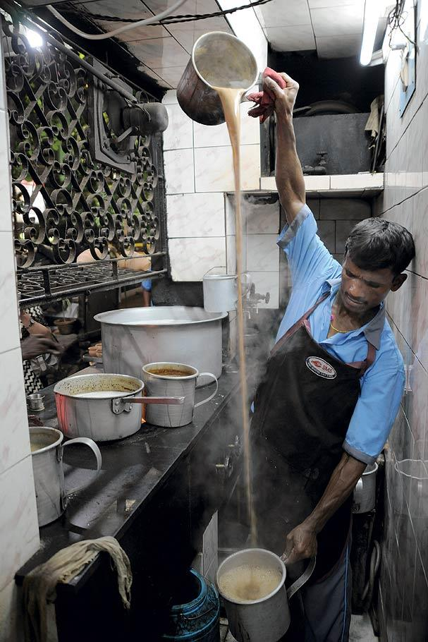 The chaiwallah pours tea from one pan to another in long movements to give the brew a frothy head. (From the book Chai: The Experience of Indian Tea, by Rekha Sarin and Rajan Kapoor; Published by Niyogi Books; Price Rs 1,995)