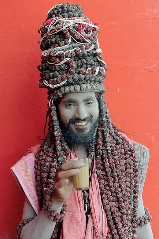 A Hindu sadhu at the momentous Ardh Kumbh Mela in Haridwar pauses to take a dhaba chai and pose for the camera.  (From the book Chai: The Experience of Indian Tea, by Rekha Sarin and Rajan Kapoor; Published by Niyogi Books; Price Rs 1,995)