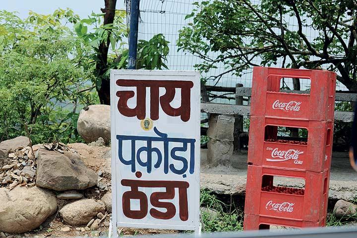 The roadside signboard translates the dynamism of India, where the popularity of tea vies with the cola culture. (From the book Chai: The Experience of Indian Tea, by Rekha Sarin and Rajan Kapoor; Published by Niyogi Books; Price Rs 1,995)
