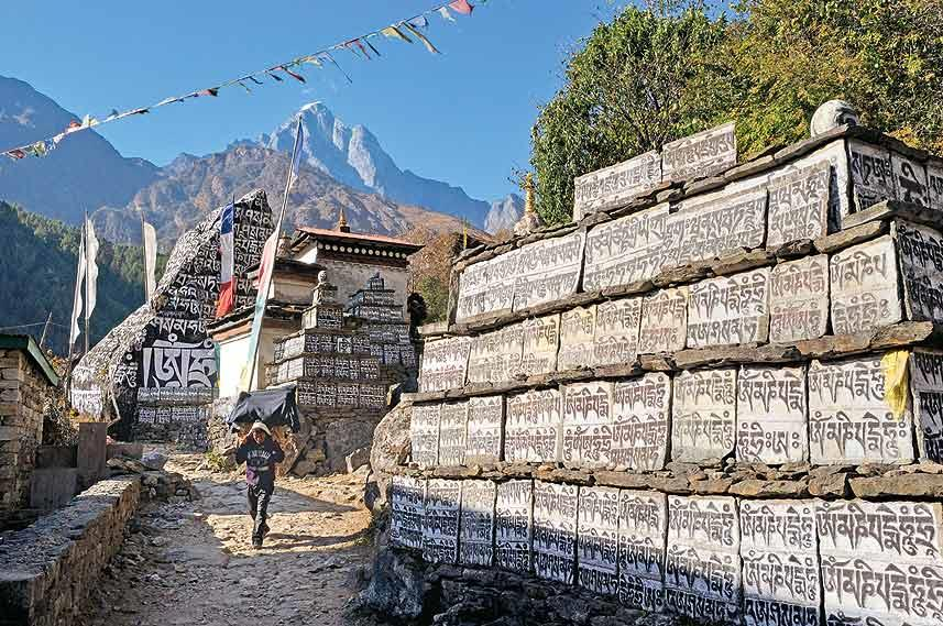 Prayer flags, mani walls and chortens adorn the village of Ghat on the first day's walk to Phakding. The Khumbu is predominantly Buddhist and this is evident all along the trail to the Base Camp