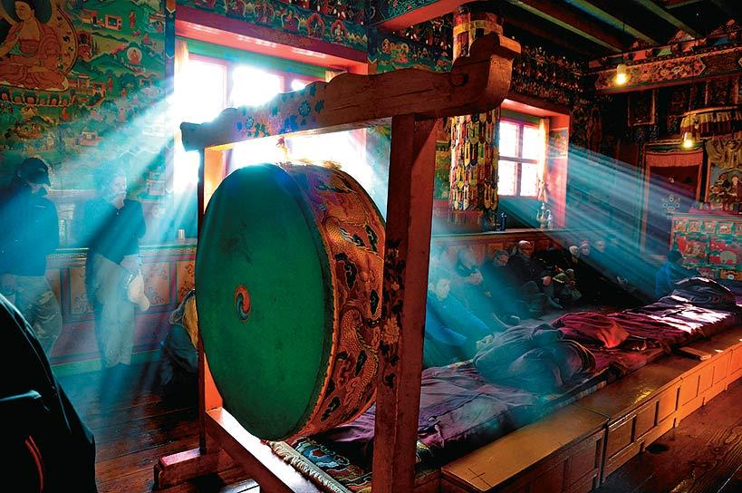 Trekkers attend a prayer service at the monastery of Thyangboche, where Everest climbers come to be blessed. This premier monastery of the Khumbu hosts the famous Mani Rimdu festival every autumn