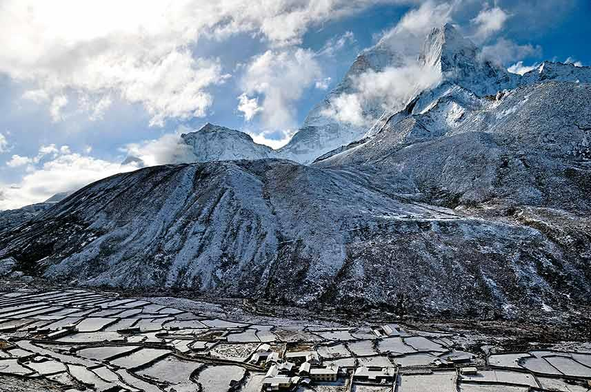 Spring turns to winter, as an unseasonal storm takes us by surprise in Dengboche and freezes the Imja Khola
